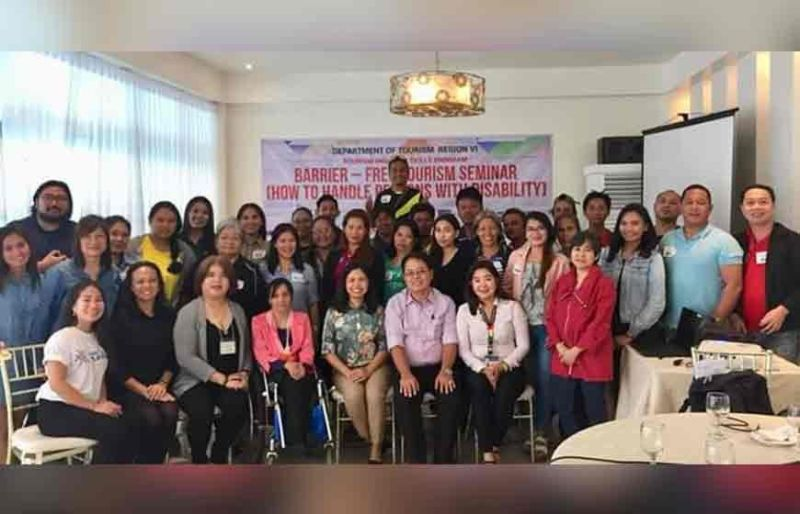 BACOLOD. Provincial Supervising Tourism Operations Officer Cristine Mansinares (seated third from right) with speakers and participants of the Barrier-free Tourism Seminar for tourism frontline service providers in Bacolod City Thursday. (Contributed Photo)