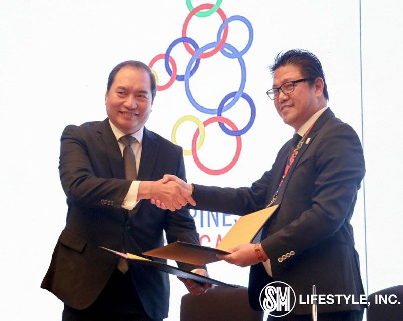 PAMPANGA. SM Lifestyle Inc., the lifestyle and entertainment arm of SM Prime Holdings, is now an official venue partner of the upcoming 30th Southeast Asian (SEA) Games this November 30 to December 11. In photo, SM Lifestyle COO, Herman Medina-Cue shakes hands during the signing ceremony with Ramon Suzara, COO of Philippine Southeast Asian Games Organizing Committee (Phisgoc) to signify SM Lifestyle's support for the upcoming 30th SEA Games. (Contributed photo)