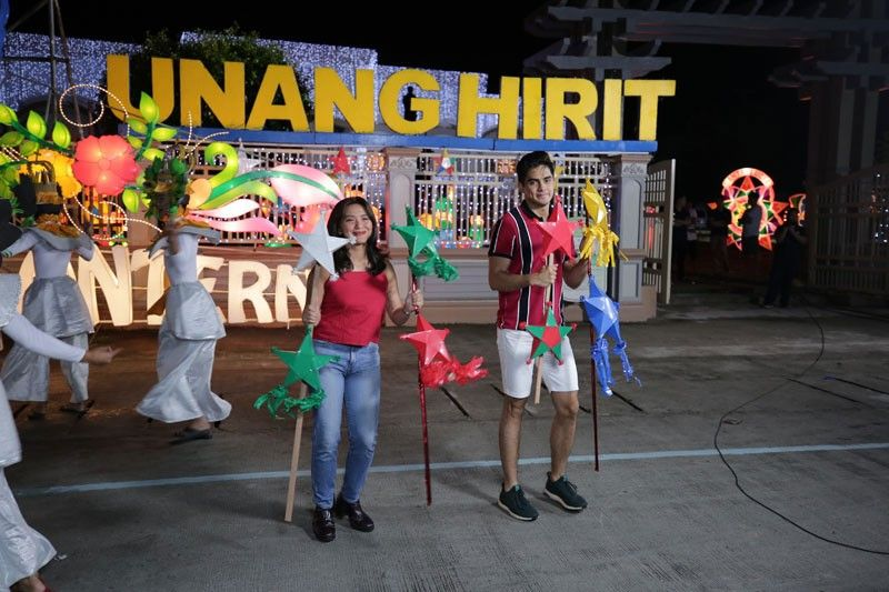 CITY OF SAN FERNANDO. Juancho Trivino and Joyce Pring, hosts of morning show Unang Hirit, feature the beautiful lights and lanterns displayed at Heroes Hall on November 7. (Contributed photo)