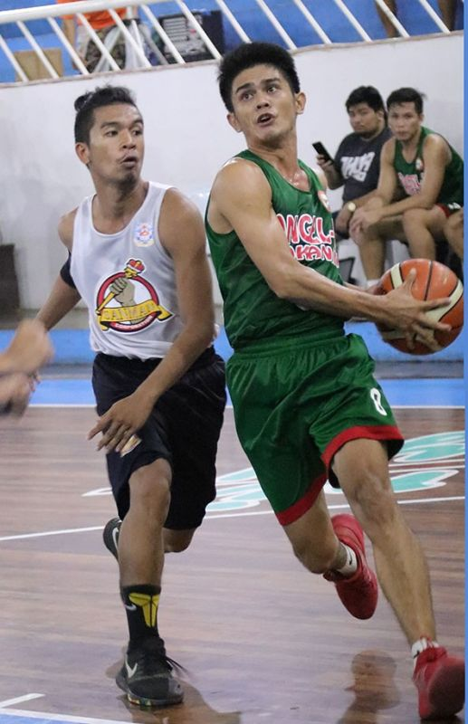 DAVAO. BJ Flores of DMMA College of Southern Philippines (DCSP) drives to the basket against a Mats College of Technology defender during their 2019 Collegiate Sponsors League (CSL) Escandor Cup game Friday evening at the Almendras Gym Davao City Recreation Center. (Mark Perandos)