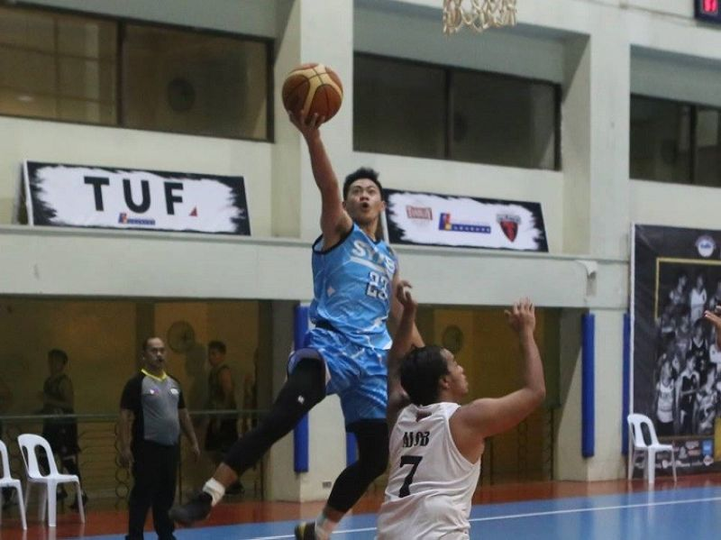 CEBU. Sykes' guard Earldred Montilla scores on a lay-up. (Contributed photo)
