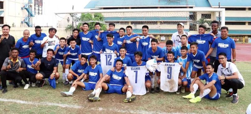 CHAMPIONS. Members of the Don Bosco Technical College football team and coaching staff celebrate after winning the Cebu Schools Athletic Foundation Inc. title. (SUNSTAR FOTO / AMPER CAMPAÑA)