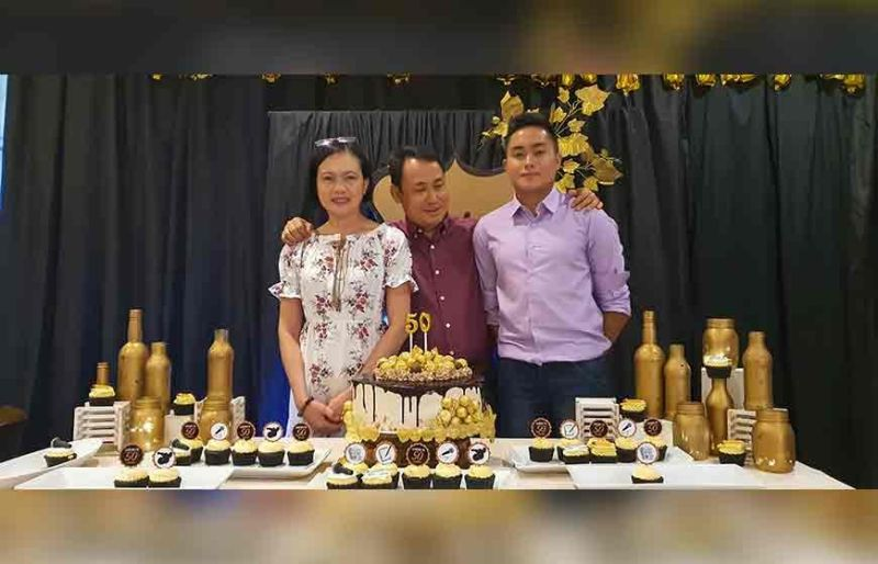 BACOLOD. Birthday celebrator Mitch Lipa with his wife Grace and son Myron Lipa during his birthday celebration held at Nature's Village in Talisay City, Negros Occidental on November 10. (Carla N. Canet)