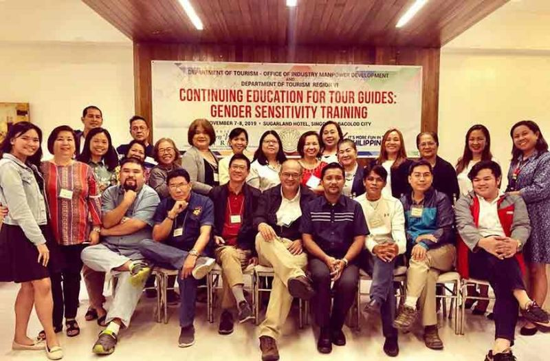 BACOLOD. Provincial Supervising Tourism Operations Officer Cristine Mansinares (third from left) with resource speaker Atty. Shangrila Quezon (standing, eight from right) and participants of the training on gender sensitivity for DOT-trained and accredited tour guides in Bacolod City recently. (Contributed Photo)