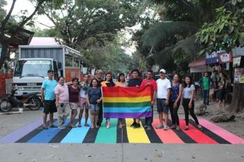 CAGAYAN DE ORO. Members of the Sangguniang Kabataan of Barangay Nazareth, Cagayan de Oro City, paint a rainbow-colored pedestrian lane in one of the village's roads to signify support to the Lesbian Gay Bisexual, Transgender, and Queer (LGBTQ) community. (Photo courtesy of Barangay Nazareth SK)    onerror=