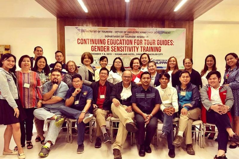 Provincial Supervising Tourism Operations Officer Cristine Mansinares (third from left) with resource speaker Atty. Shangrila Quezon (standing, eight from right) and participants of the training on gender sensitivity for DOT-trained and accredited tour guides in Bacolod City recently. (Contributed photo)