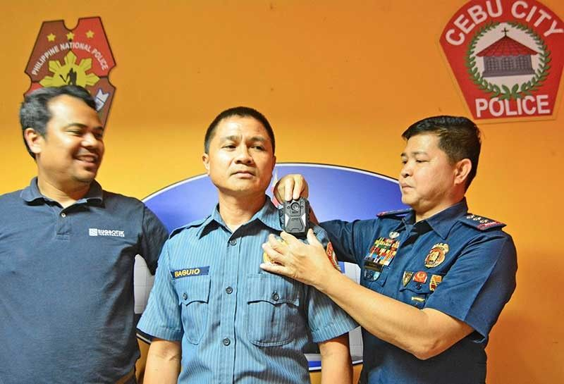 CEBU. In this photo taken in December 2017, police show where body cameras are attached to. The Cebu City Police Office received six body cameras donated by Sugbutek. (Photo by Amper Campaña/SunStar Cebu)