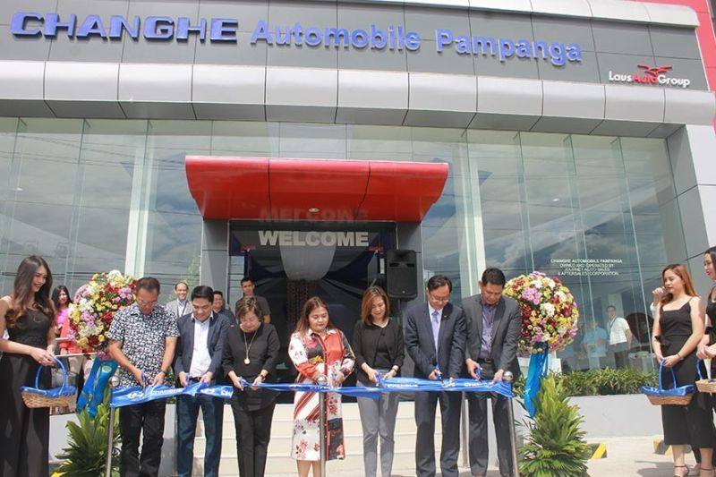 PAMPANGA. Third District Board Member Rosve Henson, LGC COO Alfie Adriano, LausGroup matriarch Tess Laus, Second District Board Member Mylyn Pineda-Cayabyab, LGC Chairman and CEO Lisset Laus-Velasco, BAIC/Changhe International Sales Manager Robbie Liu and Changhe Philippines General Manager Donald Calma cut the ribbon signaling the opening of Changhe Automobile Pampanga in Bacolor town on Tuesday, November 12, 2019. (JTD)