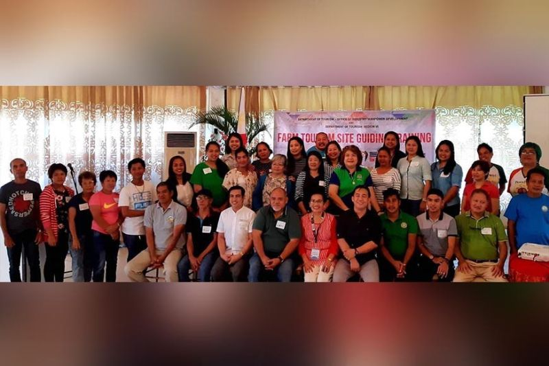 BACOLOD. Participants with resource person Angeles Gabinete (seated center), Jennylind Cordero of Negros Occidental Tourism Division and Arianne Balbidades of DOT-Western Visayas during the two-day training on farm tourism site guiding in Bacolod City until Tuesday, November 12, 2019. (Contributed Photo)