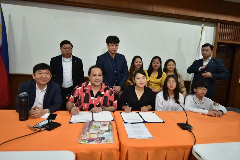 PAMPANGA. Governor Dennis 'Delta' Pineda and Gukwibu of Korea Chief Officer Kyoung Sun Yoo sign the certificate of receipt of donation together with some beneficiaries from the Children's Joy Foundation. (Contributed photo)