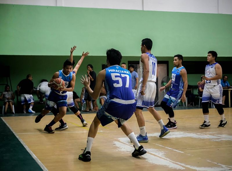 A player from Suarez Water Treatment drives along the baseline against the defense of RMA Logistics. <b>(Contributed photo)</b>