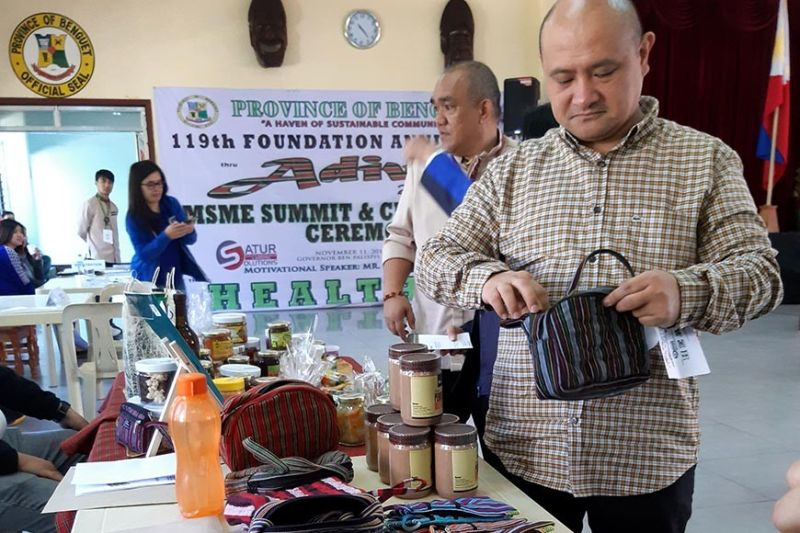 BENGUET. Benguet Governor Melchor Diclas appreciates locally produced products of the Micro, Small and Medium entrepreneurs on display at the Benguet Capitol. (Redjie Melvic Cawis)