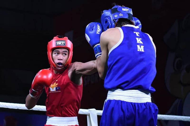 HIT. Norlan Petecio of the Philippines, left, lands a left hook against Eziz Muhammetmyradov of Turkmenistan in their lightweight division preliminary bout Tuesday evening, Philippine time, in the ongoing Asian Youth Boxing Championships 2019 in Ulaanbaatar, Mongolia. (ASBC Facebook)