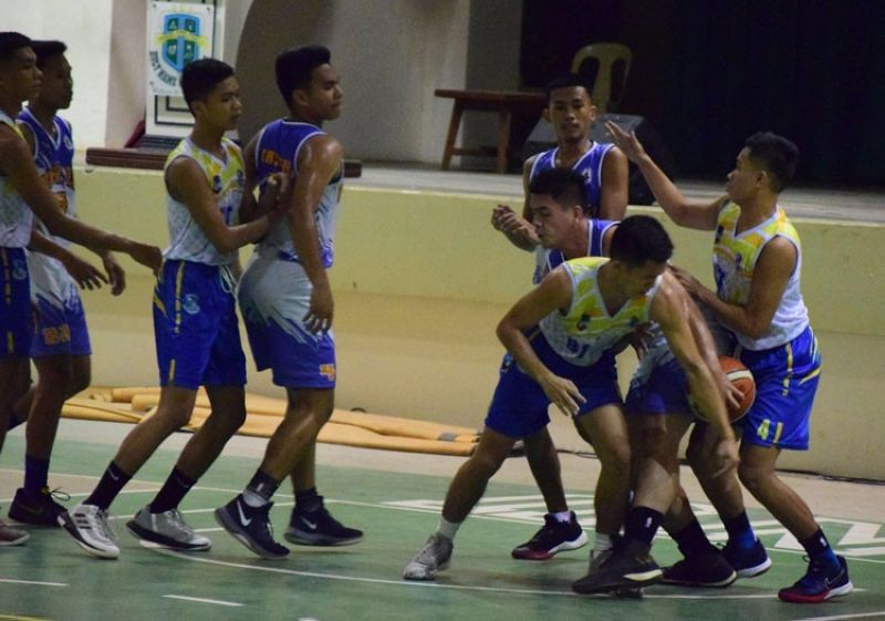 Players from BIT International College and Mater Dei College go for the loose ball in their game in the BSAA. (Contributed foto)