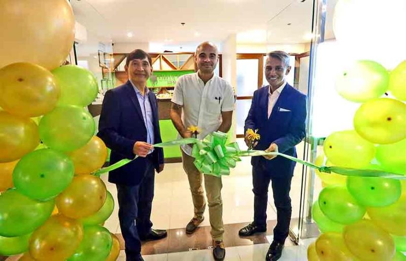 EXPANSION. From left, Dr. David Alesna, Domiku Ugarte, vice president of Hotel. Resort  and Restaurant Association of Cebu, and Dr. Gamaliel Urbi during the opening of Green Apple Dental Clinic in Mactan Newtown.(Contributed Photo)