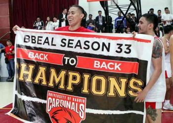 WOOED. University of Baguio Cardinals Efren dela Cruz lifts the championship banner after toppling University of the Cordilleras Jaguars in their championship match. Dela Cruz, together with four other Cardinals are reportedly being wooed to play in Manila. (Photo by Jean Nicole Cortes)