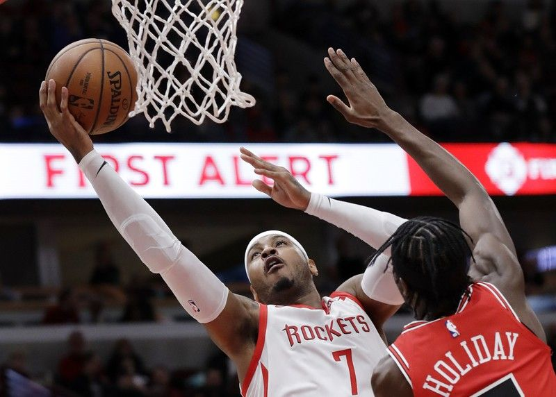 NEW YORK. In this November 3, 2018, file photo, Houston Rockets forward Carmelo Anthony (left) drives to the basket against Chicago Bulls forward Justin Holiday during the first half of an NBA basketball game in Chicago. A person familiar with the details said Anthony is returning to the NBA with the Portland Trail Blazers. The 10-time All-Star has not played since a short stint with the Rockets ended a little more than a year ago after just 10 games. (AP)