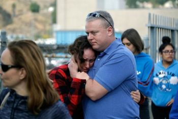CALIFORNIA. Students are escorted out of Saugus High School as some parents join them after reports of a shooting on Thursday, November 14, in Santa Clarita, California (AP)