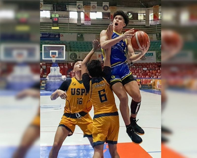 ANOTHER SHOT. Isaiah Blanco (right) had 17 points as the University of Cebu returns to the final for the second straight year. (Sun Star Photo/Arni Aclao)