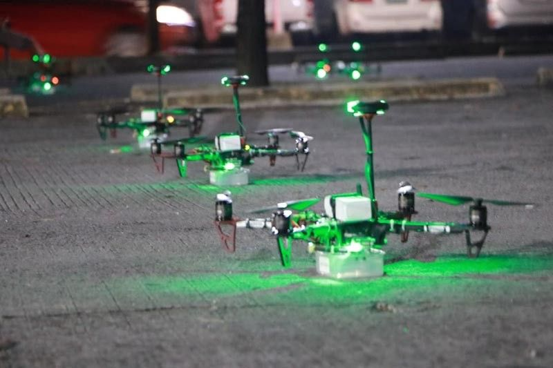 PAMPANGA. Drones get ready to fly for the Dance Drone Show on Friday at the South Parking of SM City Clark. (Chris Navarro)