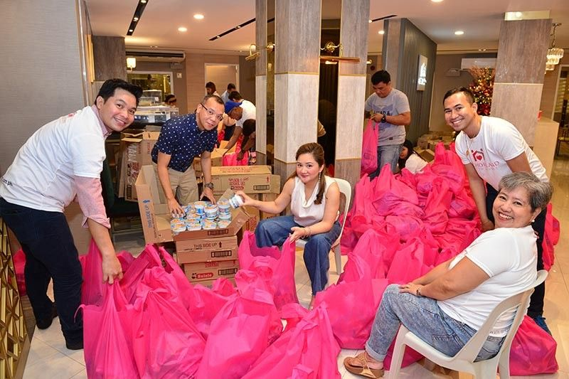 HELPING HANDS. Anchor Land president Elizabeth Ventura (center) together with volunteers pack relief items at their showroom along Jacinto St., Davao City. The company, which is currently developing 202 Peaklane along C.M. Recto St., donated 300 packs of relief items for earthquake victims. (Photo by Anchor Land Holdings, Inc.)