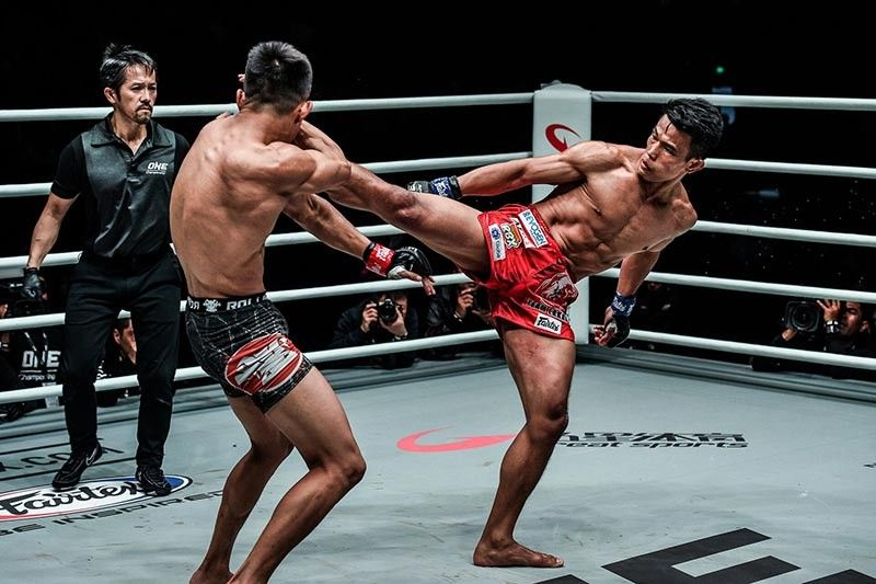 """TRADEMARK. Even with the trademark striking prowess of Team Lakay's Edward Kelly did not stop his opponent Tang Kai from securing a victory in the undercard of ONE Championship's """"Age of Dragons"""" at the Cadillac Arena in Beijing, China. (ONE Championship photo)"""