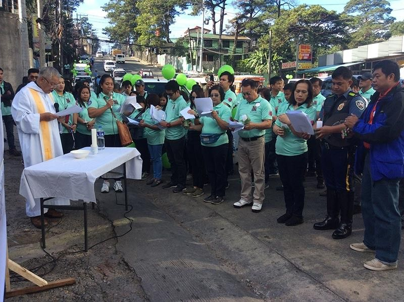 BAGUIO. Land Transportation Office Cordillera Director Francis Ray Almora, together with government agencies and members of the civil society, commemorates the United Nations observance of World Day of Remembrance for road crash victims on Buhagan (formerly Bokawkan) road. (Jonathan Llanes)
