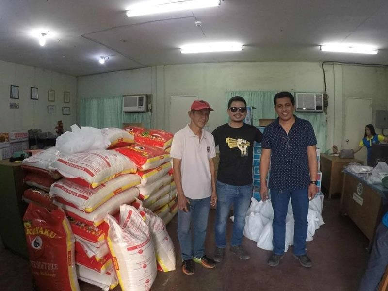 BACOLOD. Mill District Development Council chairman Edgardo Sarmiento (right) and Mill District officer Ireneo Nunez (left) receive the assistance from Tatak Kalamay representative Julian Gatuslao, for distribution to over 150 families from the towns of Matalam, Mlang, Tulunan and Cotabato covered by the Cotabato Mill District who were affected by the recent earthquake in Mindanao. (Contributed Photo)