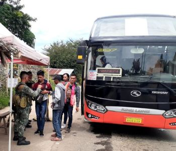 """ZAMBOANGA. A personnel of the Marine Battalion Landing Team-11 checks the identification (ID) papers of inbound passengers from nearby provinces in line with the city government's policy of """"No ID, No Entry"""" that had been in place since the imposition of Martial Law in Mindanao. (SunStar Zamboanga Photo)"""
