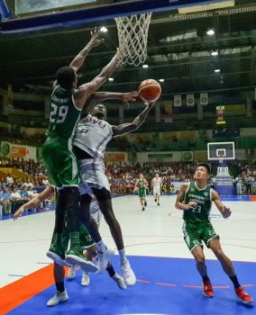 Lamine Thiam (middle) filled the stat-sheet up for SWU-Phinma in their Game 1 win over the reigning champions UV Green Lancers. (SunStar foto/Arni Aclao)