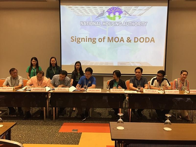 ILOILO. Cabinet Secretary Karlo Alexei Nograles (4th from left) leads the signing of memorandum of agreement and Deed of Donation and Acceptance (Doda) for the turnover of eight Yolanda housing projects at Park Inn Hotel  Tuesday, November 19, 2019. (Leo Solinap)