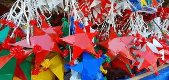 The star-shaped parols and other Christmas decorations created by the persons deprived of liberty detained at the Negros Occidental District Jail in Barangay Abuanan, Bago City are being sold at Barangay 9, near the former location of the Provincial Jail.