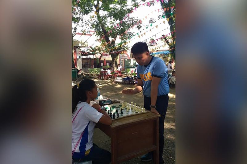 DAVAO. A Philippine National Police officer instructs a participant during a simultaneous chess event of the Mindanao Sports for Peace Caravan at the Cotabato City State Polytechnic College Tuesday, November 19, 2019. (Marianne L. Saberon-Abalayan)