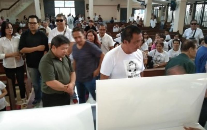 "DUMAGUETE. Dumaguete Mayor Felipe Antonio Remollo and Negros Oriental Governor Roel Degamo (left to right) view the remains of the late broadcaster Dindo Generoso shortly before he was laid to rest on Saturday, November 16, 2019, in Dumaguete City. The mayor has vowed not to stop until the ""mastermind"" behind Generoso's death is unmasked. (Photo by Juancho Gallarde)"