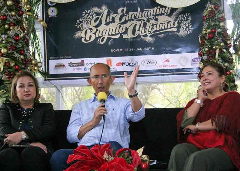 ENCHANTING CHRISTMAS. Mayor Benjamin Magalong invites the public to an enchanting Christmas in Baguio City spearheaded by the Baguio Tourism Council (BTC). With him is the Department of Tourism CAR – OIC Jovi Ganongan (right) and Gladys Vergara de Vera, BTC chair. (Photo by Jean Nicole Cortes)