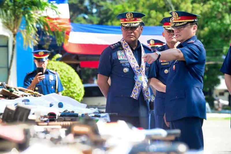 Western Visayas Chief Police Brigadier General Rene Pamuspusan points to Deputy Chief, Philippine National Police (PNP) for Operations, Police Lieutenant General Camilo Pancratius Cascolan the firearms that were seized and deposited on different police stations in Western Visayas during the relaunching of TKAL (Tokhang Kontra Armas Luthang-Revitalized TKGP) at Police Regional Office 6 (PRO-6) Camp Martin Delgado, Iloilo City on Thursday, November 21, 2019. (LEO SOLINAP)