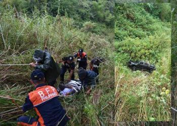 RESCUE. Kabayan Municipal Police Station, Bureau of Fire Protection in Kabayan together with concerned citizens retrieve a passenger of a pick–up truck after plunging into a 100 meter ravine (inset) at Sitio Alekak, barangay Kabayan Barrio in Kabayan, Benguet. (Kabayan MPS photo)