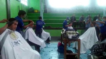 MEN'S DAY. Free haircut was given to men during the first celebration of International Men's Day at the La Trinidad municipal gym on Tuesday. Urine screening, vital signs and nutrition counseling were also provided. (Photo by Lauren Alimondo)