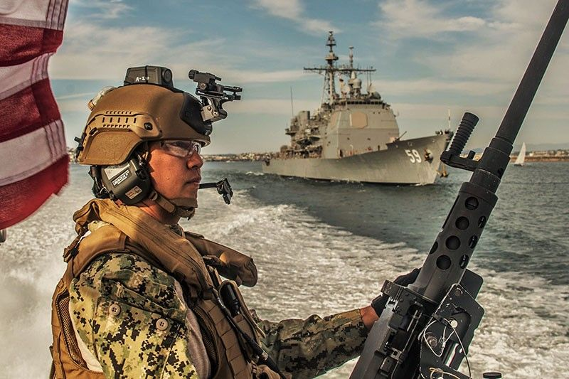 PAMPANGA. Chief Machinist Mate Mike Beltran, a native of Pampanga, Philippines, and a member of Coastal Riverine Squadron 3, mans the M2A1 .50-caliber machine gun aboard a Mark VI patrol boat as it escorts the Ticonderoga-class guided missile cruiser USS Princeton (CG-59) during a high-value asset transit escort mission as part of unit level training provided by Coastal Riverine Group 1 Training and Evaluation Unit. The Coastal Riverine Force is a core Navy capability that provides port and harbor security, high-value asset security and maritime security in the coastal and inland waterways. (Photo courtesy of Chief Boatswain's Mate Nelson Doromal Jr./US Navy)