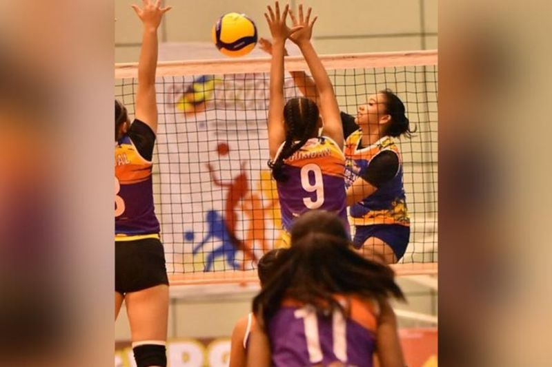 Bacolod Tay Tung High School skipper Shane Carmona scoring against 2 Iligan City National High School defenders during their first matchin the ongoingRebisco Volleyball League National Championships played at the Ynares Sports Center in Pasig City. (Rebisco Volleyball League Photo)
