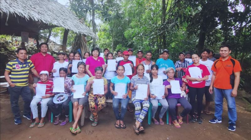 DAR Municipal Agrarian Reform Office personnel with the farmer beneficiaries during the installation rites at Sitio Agho, Barangay Camandag in La Castellana town recently. (Contributed photo)