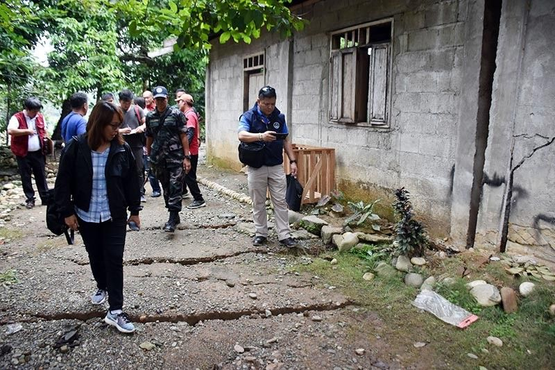 APAYAO. The Cordillera Regional Disaster Risk Reduction and Management Council, led by OCD-Cordillera Director Albert Mogol, with Apayao Governor Eleanor-Bulut-Begtang and Kabugao Mayor Bensmar Ligwang inspect the houses and the grounds affected by the tension cracks that developed during the recent prolonged rains in the province of Apayao. (Redjie Melvic Cawis)
