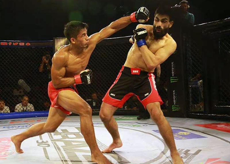 AND STILL. Despite a spirited challenge from Louie Sanoudakis, Stephen Loman defended his bantamweight title for the fourth time in the main event of Brave Combat Federation 30 in Hyderabad, India. Brave CF photo