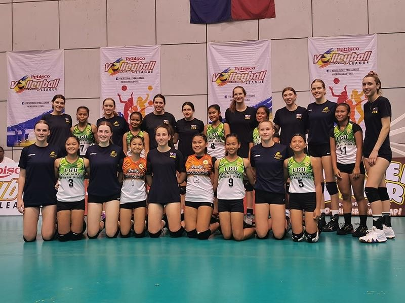 FRIENDS. Players from Talaingod, Davao del Norte and Australia pose after their exhibition games at the side event of the Rebisco Volleyball League here at Ynares Sports Arena in Pasig City. (Photo courtesy of PSC)