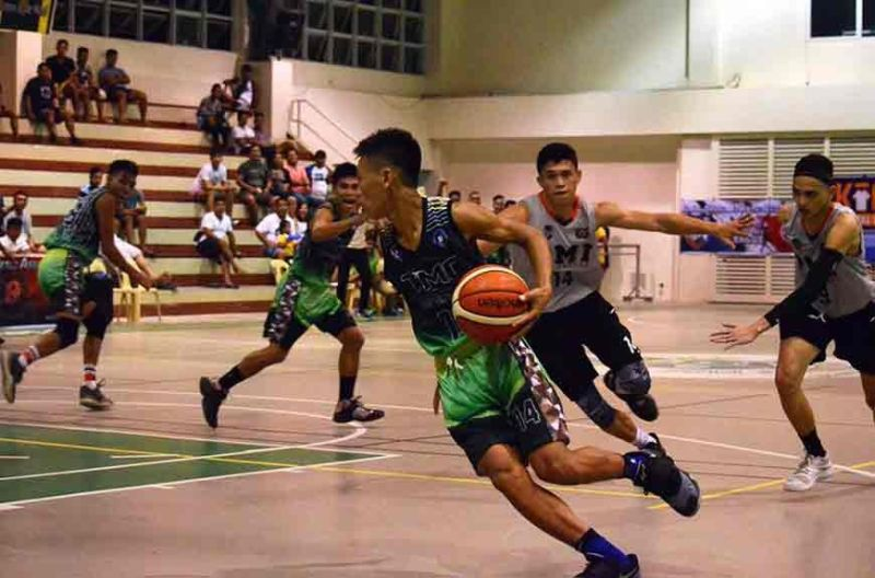 CEBU. A player from Trinidad Municipal College gets pursued by the defense of PMI Colleges. (Contributed photo)