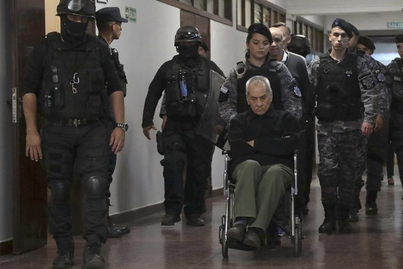 ARGENTINA. Rev. Nicola Corradi, in wheelchair, Armando Gomez and Rev. Horacio Corbacho, are escorted out of a courtroom, after being found guilty of sexual abuse of deaf children at a Catholic-run school, in Mendoza, Argentina, Monday, November 26. The court sentenced Rev. Nicola Corradi, to 42 years in prison, and Rev. Horacio Corbacho, to 45 years, for acts that occurred at the Institute in Lujan de Cuyo, a municipality in the northwestern province of Mendoza. The court also sentenced gardener Armando Gómez to 18 years in prison. (AP)