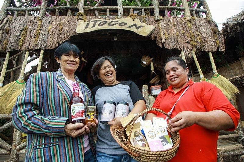 BENGUET. Women from Itogon, Benguet proudly showcase their local products such as the award winning Dulche chocolates, honey, coffee and wine among others. Locals prove that Itogon has more to offer than mining. (Jean Nicole Cortes)