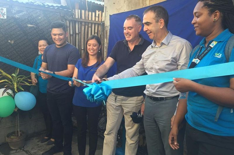 FOR WATER'S SAKE. Talisay City, Cebu Mayor Gerald Anthony Gullas Jr. (second from left) joins the ribbon-cutting ceremony in Sitio Sawsawan in Barangay San Roque, Talisay City to officially open the water network, which will be operated by Eau et Vie (E&V) Tubig Pag-Asa. Present at the event were (from left) E&V Tubig Pag-Asa program manager Maridette Tabuco, Metropolitan Cebu Water District community relations and external affairs manager Charmaine Janis Kara, Vitens Evides International project manager Patrick Egan, French Embassy Counsellor for Cooperation and Cultural Affairs Jean-Jacques Forté and E&V Water and Life Philippines program manager Suzanne Assane-Aly. (Contributed photo)