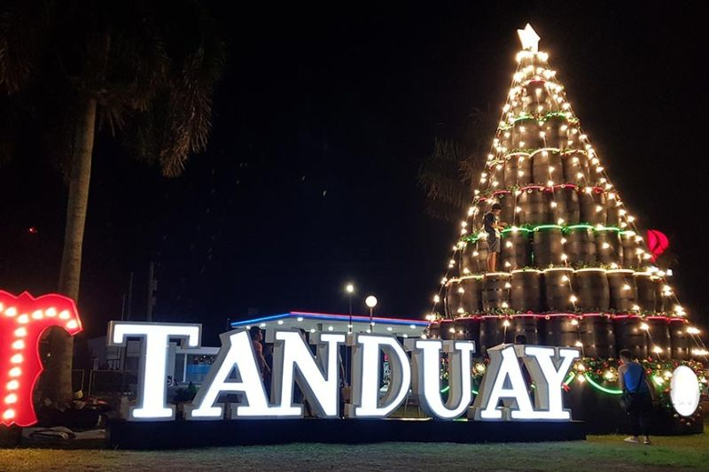 The 29-foot tree made of Tanduay barrels filled with colorful holiday décor is lighting up the New Government Center in Bacolod City. (Contributed photo)