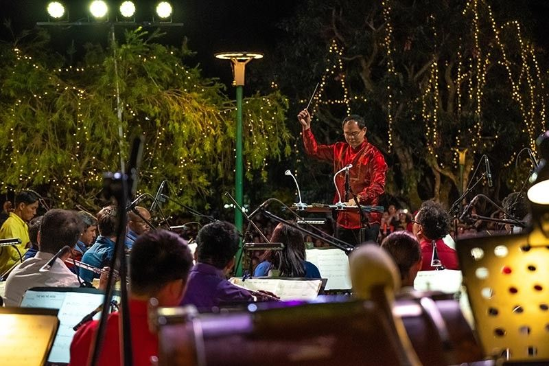 BAGUIO. The Philippine Philharmonic Orchestra serenades Baguio residents Sunday evening during the opening of the 40 day An Enchanting Baguio Christmas led by the Baguio Tourism Council in cooperation with the city government. (Photo by Red Aquino)